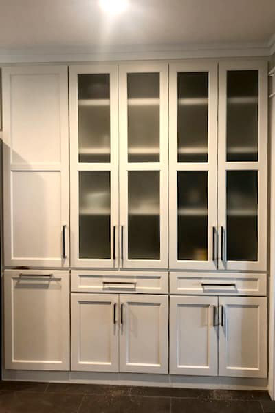 White cabinets with glass upper windows