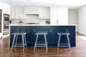 Blue kitchen island in a white kitchen