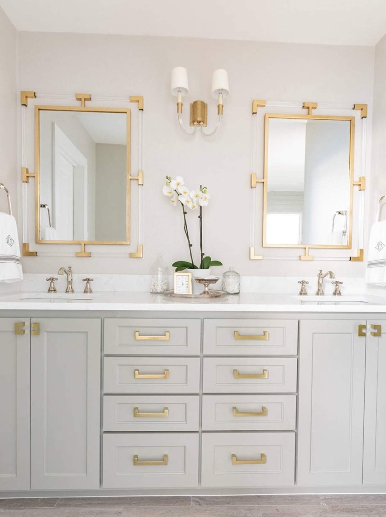 Modern white shaker style bathroom vanity with gold fixtures