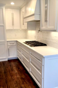 Cabinets with pulls with stove and vent hood