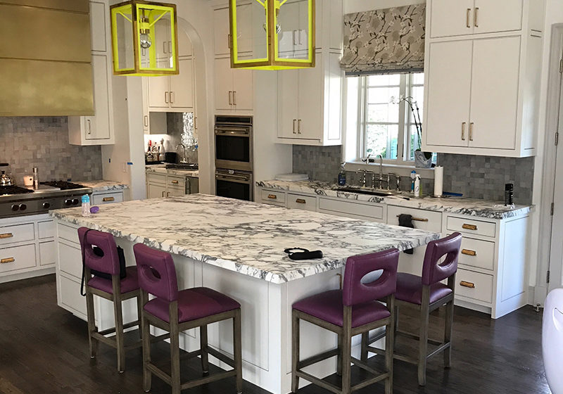 White kitchen remodel with yellow light frames